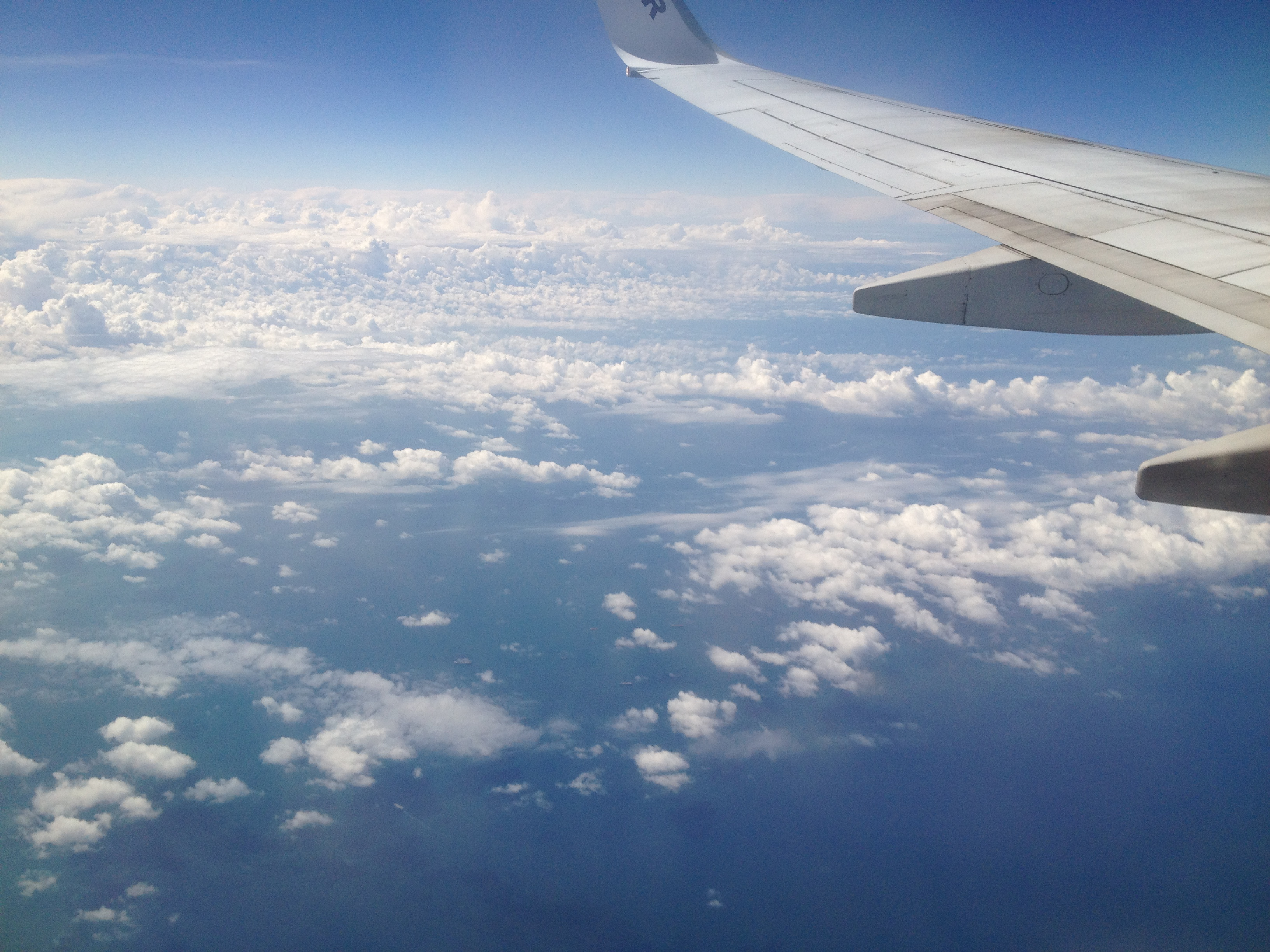 9b32aa6be6a9 airplane and clouds. airplane and clouds · Condé Nast Traveler ...